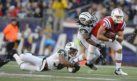 New England Patriots Tight End Rob Gronkowski (r) is Tackled by New York Jets Laron Landry (l) and Isaiah Trufant (c) in the Second Quarter of Their Game at Gillette Stadium in Foxborough Massachusetts Usa 21 October 2012 United States Foxborough