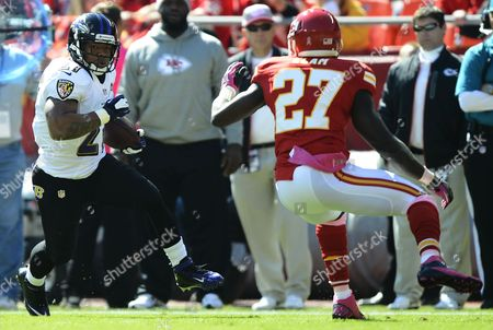 Baltimore Ravens Player Ray Rice (l) Runs the Ball Against Kansas City Chiefs Player Abram Elam (r) in the First Half of the Game at Arrowhead Stadium in Kansas City Missouri Usa 07 October 2012 United States Kansas City