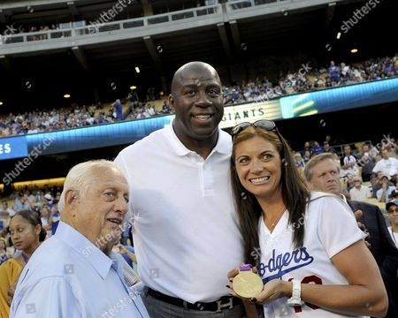 Former Los Angeles Dodgers Manager Tommy Lasorda (l) and Ervin 'Magic' Johnson (c) Pose For Pictures with Olympic Gold Medalist Misty May-treanor (r) Prior to the Dodgers' Game Against the San Francisco Giants at Dodger Stadium in Los Angeles California Usa 20 August 2012 Treanor a Three-time Olympic Gold Medalist in Beach Volleyball is Married to Dodgers Catcher Matt Treanor United States Los Angeles
