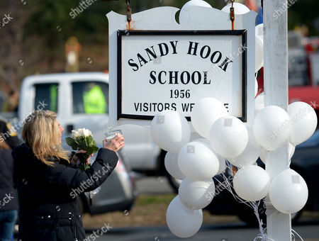 Andrea Jaeger Holds a Candle Up at a Memorial Following a Shooting on 14 December That Left at Least 28 People Dead 20 of Them Young Children in Newtown Connecticut Usa 15 December 2012 Reports State on 14 December 2012 That a Gunman Unleashed a Hail of Gunfire That Killed 20 Children and Six Adults at a School in Newtown a Quiet Affluent Suburb of 27 500 People About 100 Kilometres North-east of New York City He Then Killed Himself Inside Sandy Hook Elementary School Having Previously Killed His Mother United States Newtown