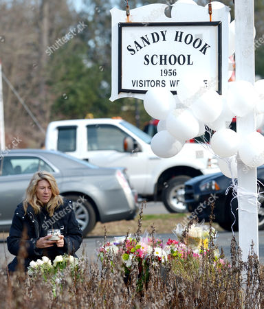 Andrea Jaeger Holds a Candle Up and Prays at a Memorial Following a Shooting on 14 December That Left at Least 28 People Dead 20 of Them Young Children in Newtown Connecticut Usa 15 December 2012 Reports State on 14 December 2012 That a Gunman Unleashed a Hail of Gunfire That Killed 20 Children and Six Adults at a School in Newtown a Quiet Affluent Suburb of 27 500 People About 100 Kilometres North-east of New York City He Then Killed Himself Inside Sandy Hook Elementary School Having Previously Killed His Mother United States Newtown