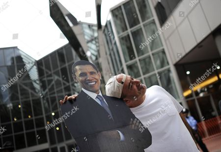 Stock Picture of Matt Servitto of New York City Stops to Pose For a Photo with a Cardboard Cutout of Us President Barack Obama During the Carolina Fest Street Party in the Area of the 2012 Democratic National Convention in Charlotte North Carolina Usa 3 September 2012 United States Charlotte