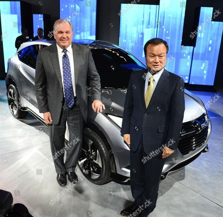 John Mendel (l) Executive Vice President of Auto Sells America Honda Along with Takanobu Ito (r) President and Ceo of Honda Stand in Front of the Urban Suv Concept Car at the Honda Press Conference at the North American International Auto Show at the Cobo Center in Detroit Michigan Usa 14 January 2013 the North American International Auto Show is One of the Largest Car Shows Held Each Year in the United States and Opens to the Public 19 January 2013 United States Detroit
