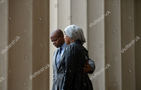 Nafissatou Diallo (r) the Woman who Has Sued Dominique Strauss-kahn For Sexual Assault Leaves Bronx Supreme Court with Her Lawyers Kenneth P Thompson (l) Following a Hearing with a Judge in Which the Two Sides in the Case Agreed to a Confidential Settlement in the Bronx New York Usa 10 December 2012 Strauss-kahn Allegedly Forced Himself on Diallo After She Went to Clean His Hotel Room in New York in May 2011 United States Bronx