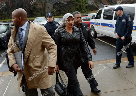 Nafissatou Diallo (c) the Woman who Has Sued Dominique Strauss-kahn For Sexual Assault Arrives to Bronx Supreme Court with One of Her Lawyers Kenneth P Thompson (l) For a Hearing with a Judge to Update a Judge on the Status of Settlement Discussions in the Bronx New York Usa 10 December 2012 Strauss-kahn Allegedly Forced Himself on Diallo After She Went to Clean His Hotel Room in New York in May 2011 United States Bronx