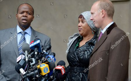Nafissatou Diallo (c) the Woman who Has Sued Dominique Strauss-kahn For Sexual Assault Stands Outside of Bronx Supreme Court with Her Lawyers Kenneth P Thompson (l) and Douglas H Wigdor (r) Following a Hearing with a Judge in Which the Two Sides in the Case Agreed to a Confidential Settlement in the Bronx New York Usa 10 December 2012 Strauss-kahn Allegedly Forced Himself on Diallo After She Went to Clean His Hotel Room in New York in May 2011 United States Bronx