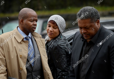 Stock Picture of Nafissatou Diallo (c) the Woman who Has Sued Dominique Strauss-kahn For Sexual Assault Arrives to Bronx Supreme Court with One of Her Lawyers Kenneth P Thompson (l) For a Hearing with a Judge to Update a Judge on the Status of Settlement Discussions in the Bronx New York Usa 10 December 2012 Strauss-kahn Allegedly Forced Himself on Diallo After She Went to Clean His Hotel Room in New York in May 2011 United States Bronx