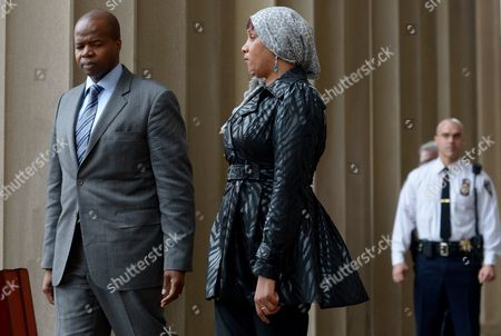 Stock Photo of Nafissatou Diallo (r) the Woman who Has Sued Dominique Strauss-kahn For Sexual Assault Leaves Bronx Supreme Court with Her Lawyers Kenneth P Thompson (l) Following a Hearing with a Judge in Which the Two Sides in the Case Agreed to a Confidential Settlement in the Bronx New York Usa 10 December 2012 Strauss-kahn Allegedly Forced Himself on Diallo After She Went to Clean His Hotel Room in New York in May 2011 United States Bronx