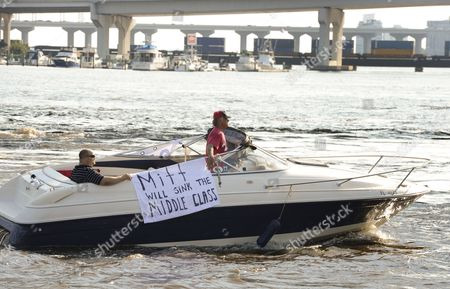 A Boater on the St John River Gives His Opinion After Former Massachusetts Governor and Republican Presidential Nominee Mitt Romney Participate in a Campaign Rally at Jacksonville Landing in Downtown Jacksonville Florida Usa 01 September 2012 United States Jacksonville