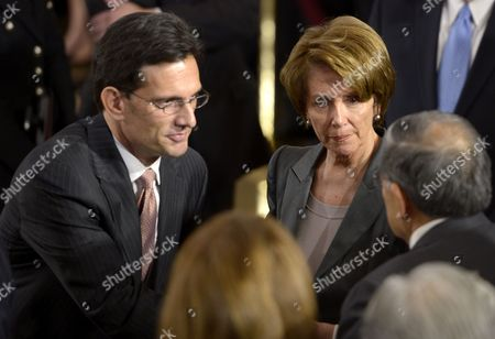 Us House Majority Leader Eric Cantor (l) and House Minority Leader Nancy Pelosi (c) Greet Former Secretary of Transportation Norman Mineta (r) As Us Democtatic Senator From Hawaii Daniel Inouye Lies in State in the Rotunda of the Us Capitol in Washington Dc Usa 20 December 2012 Because of His Seniority in 2010 Inouye Became President Pro Tempore of the Senate; This Made Him Third in the Presidential Line of Succession After the Vice President and the Speaker of the House of Representatives United States Washington