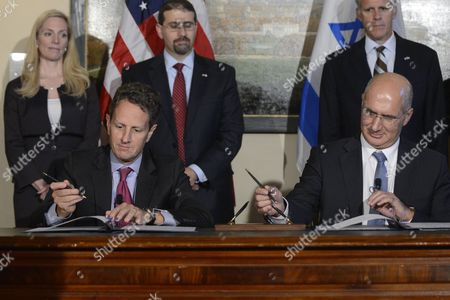 Us Treasury Secretary Tim Geithner (front L) and Israeli Finance Ministry Director General Doron Cohen (front R) Sign the Us - Israel Loan Guarantee Program During a Signing Ceremony at the Treasury Department in Washington Dc Usa 24 October 2012 United States Washington