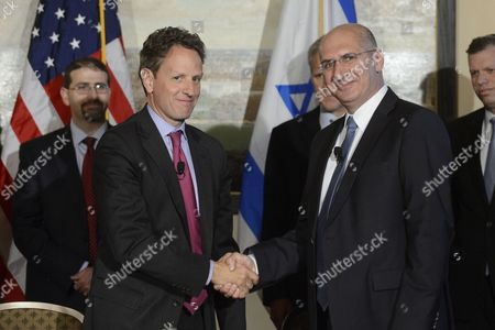 Us Treasury Secretary Tim Geithner (front L) and Israeli Finance Ministry Director General Doron Cohen (front R) Shake Hands at the Signing Ceremony For the Us - Israel Loan Guarantee Program at the Treasury Department in Washington Dc Usa 24 October 2012 United States Washington