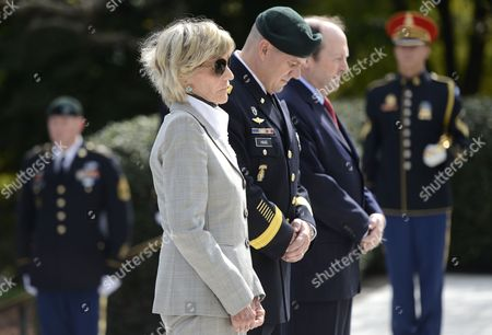Jean Kennedy Smith (l) U S Army Special Forces Commanding General Christopher Haas (2l) and Assistant Secretary of Defense For Special Operations Michael Sheehan (3l) Take a Moment of Silence During the U S Army Special Forces Command (airborne) Commemorative President John F Kennedy Wreath Laying Ceremony at President Kennedy's Grave Site in Arlington National Cemetery in Arlington Virginia Usa 18 October 2012 the Event Pays Tribute to President Kennedy's Vision of Building a Dedicated Counter Insurgency Force a Vision That Helped Build the Green Berets Into the Elite Force They Have Become Over the Last Five Decades United States Arlington