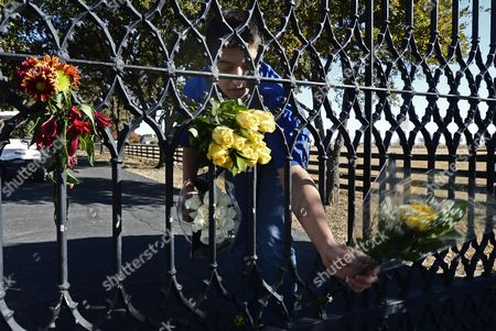 Michael Portman a Staff Member Puts Flowers on the Gate Outside at Southforkranch where the Tv Series Dallas was Based Off of and Partly Filmed in the 1970's in Parker Texas Usa 24 November 2012 Us Actor Larry Hagman Died at the Age of 81 at Medical City Hospital in Dallas Texas Larry Hagman was Known Best For His Role As J R Ewing on the Television Series Dallas United States Parker
