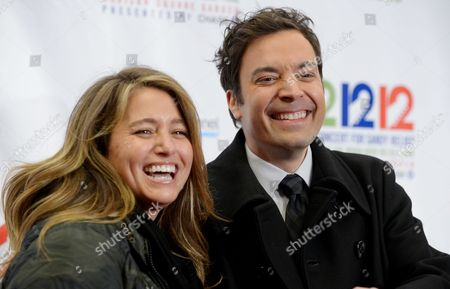 Televison Personality Jimmy Fallon (r) and His Wife Nancy Juvonen of the Us Arrive in the Press Room During the 12 12 12 Concert For Sandy Relief at Madison Square Garden in New York New York Usa 12 December 2012 a Number of Major Music Acts Including Bruce Springsteen the Rolling Stones and Paul Mccartney Are Performing to Raise Money For People Affected by Hurricane Sandy Which Hit the Region in October United States New York