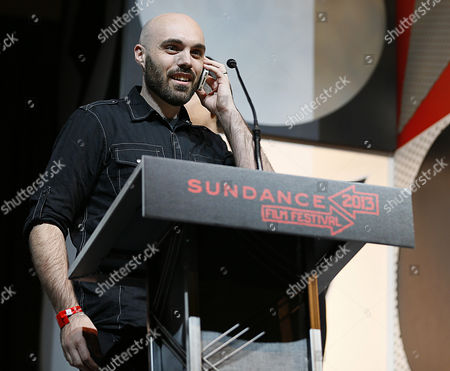 Stock Photo of Us Director David Lowery Talks to Bradford Young on His Phone who Won the Cinematography Award: Us Dramatic For the Film 'Ain't Them Bodies Saints' at the Awards Ceremony at the 2013 Sundance Film Festival in Park City Utah Usa 26 January 2013 the Festival Runs From January 17 Until 27 in Park City Utah United States Park City