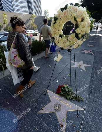People Walk by Flowers Placed by the Star of Us Actor Larry Hagman on the Hollywood Walk of Fame in Hollywood California Usa 25 November 2012 Us Actor Larry Hagman Died in Dallas Texas 23 November 2012 Hagman was Known For His His Roles in 'I Dream of Jeannie' and 'Dallas' United States Hollywood