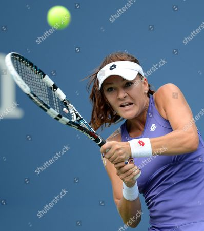 Agnieszka Radwanska of Poland Hits a Return to Nina Bratchikova of Russia During Their Match on the Second Day of the 2012 Us Open Tennis Championship at the Usta National Tennis Center in Flushing Meadows New York Usa 28 August 2012 the Us Open Runs Through Sunday 09 September 2012 United States Flushing Meadows