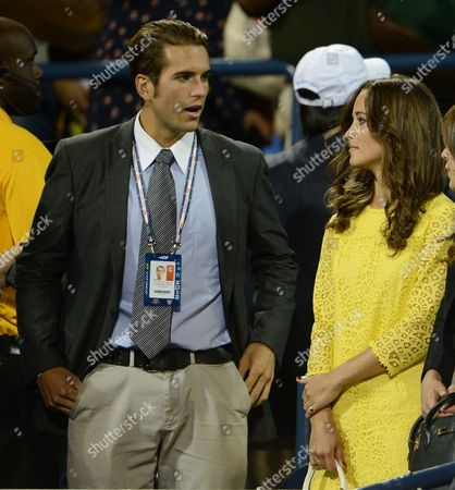 Stock Photo of Pippa Middleton Sister of Catherine Dutchess of Cambridge (r) Stands with Us Tennis Player Spencer Vegosen (l) As They Watch Andy Murray of Great Britian Play Marin Cilic of Croatia During Their Quarterfinals Round Match on the Tenth Day of the 2012 Us Open Tennis Championship at the Usta National Tennis Center in Flushing Meadows New York Usa 05 September 2012 the Us Open Runs Through Sunday 09 September 2012 United States Flushing Meadows