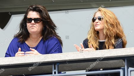Us Television Personality Rosie O'donnell (l) and Her Wife Michelle Rounds (r) Watch Novak Djokovic of Serbia Play Julien Benneteau of France During Their Match on the Seventh Day of the 2012 Us Open Tennis Championship at the Usta National Tennis Center in Flushing Meadows New York Usa 02 September 2012 the Us Open Runs Through Sunday 09 September 2012 United States Flushing Meadows