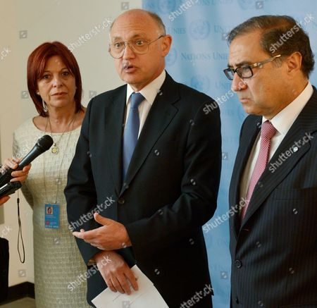 Hector Marcos Timerman (c) Foreign Minister of Argentina Speaks While Standing with Jorge Arguello (r) Argentina's Ambassador to the United States and Marita Perceval (l) Argentina's New Ambassador to the United Nations During a Press Conference Following a Meeting with United Nations Secretary-general Ban Ki-moon at United Nations Headquarters in New York New York Usa 22 October 2012 Timerman Held Meetings at the Un Today in Response to the Holding of the Argentinian Naval Ship the Libertad in Ghana After a New York Hedge Fund Manager Persuaded a Judge in That Country to Seize the Ship in an Effort to Force Argentina to Pay Unpaid Debts United States New York