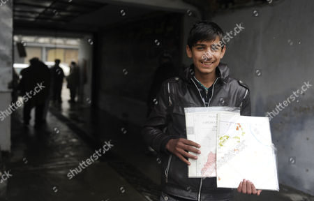Afghan Boy Fawad Mohammadi who Starred in Afghan Movie 'Buzkashi Boys' That Has Been Nominated For Oscar Sells Maps on a Roadside in Kabul Afghanistan 02 February 2013 Fawad Mohammadi who Starred in Buzkashi Boy a Short Film Nominated For Oscar Sells Maps on Streets to Earn His Livlihood As a Parallel Campaign Has Been Launched by the Film Representatives to Collect Donations For the Teenage Stars to Walk the Red Carpet at the Academy Awards This Month in Los Angeles Afghanistan Kabul