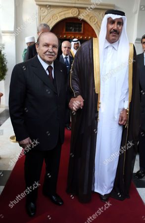 Algerian President Abdelaziz Bouteflika (l) and the Qatari Prime Minister and Minister of Foreign Affairs Sheikh Hamad Bin Jassim Bin Jabr Al-thani (r) Leave Following Their Meeting at Djenane El-mufti Residence in Algiers Algeria 11 September 2012 the Qatari Prime Minister Arrived Tuesday in Algiers For a One-day Visit Algeria Algiers