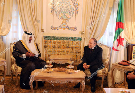 Algerian President Abdelaziz Bouteflika (r) Meets with the Qatari Prime Minister and Minister of Foreign Affairs Sheikh Hamad Bin Jassim Bin Jabr Al-thani (l) at Djenane El-mufti Residence in Algiers Algeria 11 September 2012 the Qatari Prime Minister Arrived in Algiers For a One-day Visit Algeria Algiers