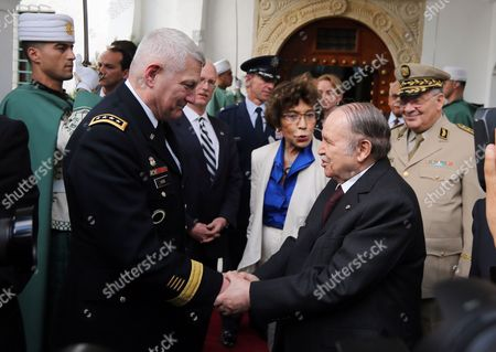 Algerian President Abdelaziz Bouteflika (r) Shakes Hands with Us General Carter F Ham (l) Commander of Us Africa Command (africom) Following Their Meeting at Djenane El-mufti Residence in Algiers Algeria 30 September 2012 According to Media Reports the Visit is Part of Regular Consultations Between the Us and Algeria and Ahead of the Strategic Dialogue Scheduled For 19 October in Washington Algeria Algiers