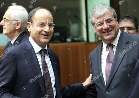 Cyprus Transport Minister Efthenios Flourentzou (r) Chats with Italian Transport Minister Antonio Di Pietro During a European Transport and Energy Ministers Council at Eu Headquarters in Brussels Belgium 20 December 2012 Belgium Brussels