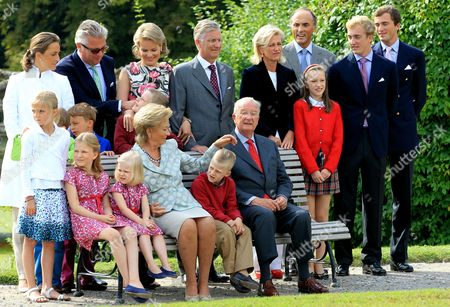 (back Row L-r) Princess Claire Prince Laurent Princess Mathilde Crown Prince Philippe Princess Astrid Prince Lorenz Prince Joachim and Prince Amedeo (middle Row L-r Standing) Princess Louise Prince Aymeric Prince Nicolas Prince Gabriel Princess Laetitia Maria (front Row L-r Sitting on Bench) Princess Elisabeth Princess Eleonore Queen Paola Prince Emmanuel and King Albert Are Pictured During a Belgian Royal Family Photoshoot at the Castle of Laeken in Brussels Belgium 02 September 2012 Belgium Brussels