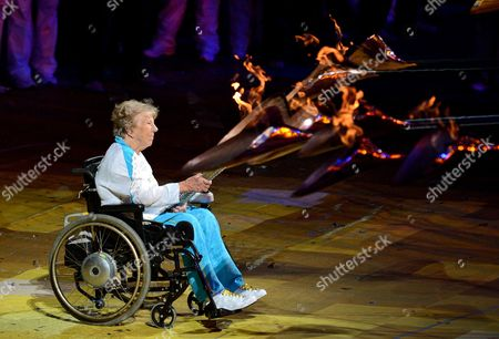 Margaret Maughan Britain's First Paralympic Gold Medalist Lights the Olympic Flame in the Olympic Stadium During the Opening Ceremony of the London 2012 Paralympic Games London Britain 29 August 2012 United Kingdom London