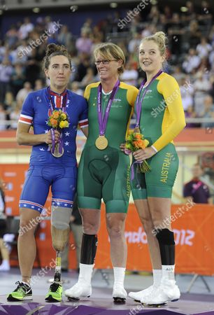 Silver Medalist Megan Fisher of Usa (l) Gold Medalist Susan Powell of Australia (c) and Bronze Medalist Alexandra Green of Australia (r) Pose on the Podium During the Medal Ceremony For the Women's Individual C4 Pursuit Cycling at the Velodrome in the Oympic Park During the London 2012 Paralympic Games London Britain 30 August 2012 United Kingdom London