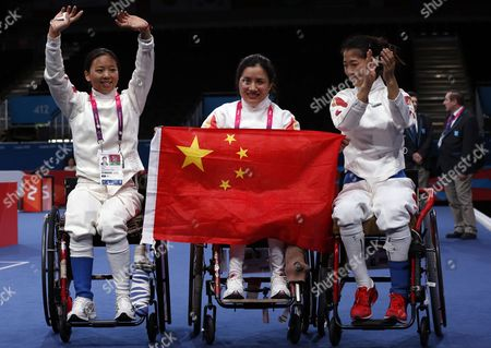 (l-r) China's Baili Wu Rong Jing and Fang Yao Celebrate Winning the Gold Medal For the Women's Epee Wheelchair Fencing Gold Medal Final During the London 2012 Paralympic Games London Britain 07 September 2012 United Kingdom London