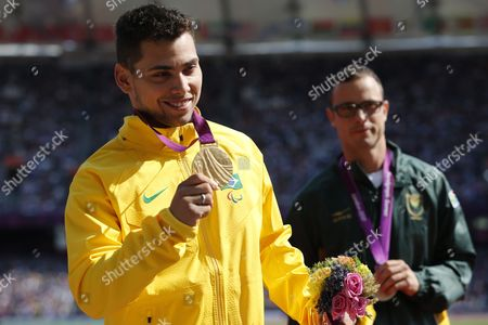 Alan Fonteles Cardoso Oliveira (l) of Brazil and Oscar Pistorius (r) of South Africa Stand During the Victory Ceremony of the Men's 200m T44 Final at Olympic Stadium During the London 2012 Paralympic Games London Britain 03 September 2012 Alan Fonteles Cardoso Oliveira of Brazil Won the Gold Medal Oscar Pistorius of South Africa Silver and Blake Leeper of Usa Bronze United Kingdom London