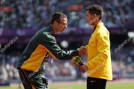 Oscar Pistorius of South Africa Silver Medal (l) and Alan Fonteles Cardoso Oliveira of Brazil Gold Medal (r) Shake Hands on the Podium Following the Men's 200m - T44 Final at the Olympic Stadium During the London 2012 Paralympic Games London Britain 03 September 2012 Alan Fonteles Cardoso Oliveira of Brazil Won the Gold Medal Oscar Pistorius of South Africa Silver and Blake Leeper of Usa Bronze United Kingdom London
