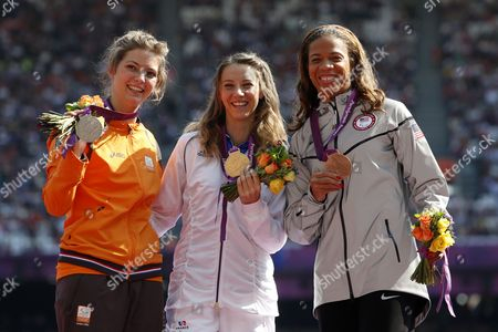 Stock Image of (l-r) Silver Medalist Marlou Van Rhijn of the Netherlands Gold Medalist Marie-amelie Le Fur of France and Bronze Medalist April Holmes of the United States of America Celebrate on the Podium Following the Women's 100m - T44 Final at the Olympic Stadium During the London 2012 Paralympic Games London Britain 03 September 2012 United Kingdom London