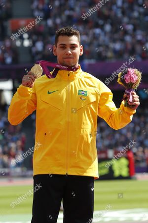 Alan Fonteles Cardoso Oliveira of Brazil Celebrates with His Gold Medal Following the Men's 200m - T44 Final at the Olympic Stadium During the London 2012 Paralympic Games London Britain 03 September 2012 Alan Fonteles Cardoso Oliveira of Brazil Won the Gold Medal Oscar Pistorius of South Africa Silver and Blake Leeper of Usa Bronze United Kingdom London