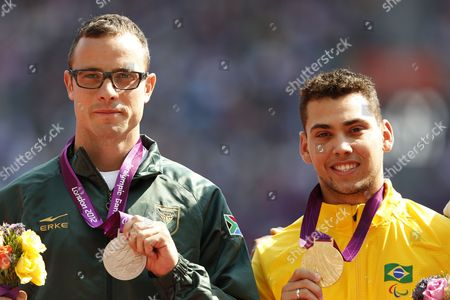 Alan Fonteles Cardoso Oliveira (r) of Brazil and Oscar Pistorius (l) of South Africa Stand During the Victory Ceremony of the Men's 200m T44 Final at Olympic Stadium During the London 2012 Paralympic Games London Britain 03 September 2012 Alan Fonteles Cardoso Oliveira of Brazil Won the Gold Medal Oscar Pistorius of South Africa Silver and Blake Leeper of Usa Bronze United Kingdom London
