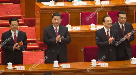 (l-r) Former Chinese President Hu Jintao Newly Elected President Xi Jinping Former Premier Wen Jiabao and Newly Elected Premier Li Keqiang Take Their Places As They Arrive at the Closing Session of the National Peoples Congress (npc) in the Great Hall of the People in Beijing China 17 March 2013 China's Nominal State Parliament Closed After Installing a New Leadership Line Up with Xi Jinping As President and Li Keqiang As Premier China Beijing