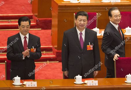 Former Chinese President Hu Jintao (l) Former Premier Wen Jiabao (r) and Newly Elected President Xi Jinping (c) Take Their Places As They Arrive at the Closing Session of the National Peoples Congress (npc) in the Great Hall of the People in Beijing China 17 March 2013 China's Nominal State Parliament Closed After Installing a New Leadership Line Up with Xi Jinping As President and Li Keqiang As Premier China Beijing