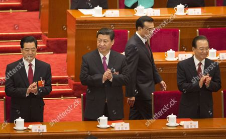 (l-r) Former Chinese President Hu Jintao Newly Elected President Xi Jinping Newly Elected Premier Li Keqiang and Former Premier Wen Jiabao Take Their Places As They Arrive at the Closing Session of the National Peoples Congress (npc) in the Great Hall of the People in Beijing China 17 March 2013 China's Nominal State Parliament Closed After Installing a New Leadership Line Up with Xi Jinping As President and Li Keqiang As Premier China Beijing
