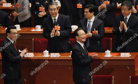 Newly-elected Chinese Premier Li Keqiang and Former Premier Wen Jiabao Walks Arrives After the Election of the New Premier of China at the 12th National People's Congress (npc) in the Great Hall of the People in Beijing China 15 March 2013 China's Nominal State Parliament on 15 March Appointed Li Keqiang As the Nation's Premier to Succeed Wen Jiabao China Beijing