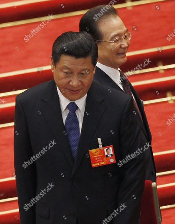 Former Premier Wen Jiabao (back) Walks Past President Xi Jinping As They Arrive For the Announcement of the Election Results of the New Premier of China at the 12th National People's Congress (npc) in the Great Hall of the People in Beijing China 15 March 2013 China's Nominal State Parliament on 15 March Appointed Li Keqiang As the Nation's Premier to Succeed Wen Jiabao China Beijing