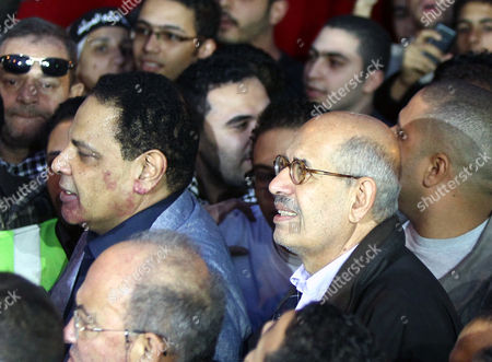 Nobel Peace Prize Winner and Leader of Adoustour Party Mohamed Elbaradei (r) and Egyptian Novelist Alaa Al-aswany (l) Join Egyptian Protesters During a March Against President Mohamed Morsi Decree at Shubra District Cairo Egypt 27 November 2012 Thousands Took to the Streets Across Egypt to Protest a Decision by President Mohamed Morsi to Grant Himself Sweeping Powers Protesters in Cairo Converged on Tahrir Square where a Sit-in Began on 23 November After the Islamist Leader Signed a Decree Making All His Decisions and Laws Immune From Legal Challenge Egypt Cairo
