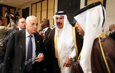 Qatari Prime Minister and Foreign Minister Sheikh Hamad Bin Jassim Bin Jabr Al-thani (c) and Arab League Secretary General Nabil Al-arabi (l) Attend the Arab Foreign Ministers 139th Annual Meeting in Cairo Egypt 06 March 2013 the Meeting is Expected to Discuss Different Topics with Focus on Syria Crisis and the Palestinian Issue Egypt Cairo