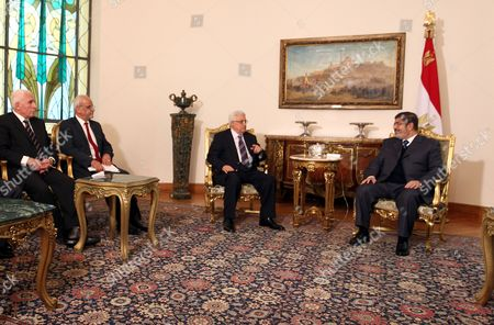 Egyptian President Mohamed Morsi (r) Meets with Palestinian President Mahmoud Abbas (2-r) Palestinian Negotiator Saeb Erek (2-l) and Head of the Palestinian Fatah Delegation Azzam El-ahmad (l) at the Presidential Palace in Cairo Egypt 09 January 2013 According to Media Reports Egyptian President Mohamed Morsi Will on 09 January Meet President Mahmoud Abbas of the Fatah Party and Hamas Leader Khaled Meshaal to Push Unity Talks Between the Rival Palestinian Groups Egypt Cairo