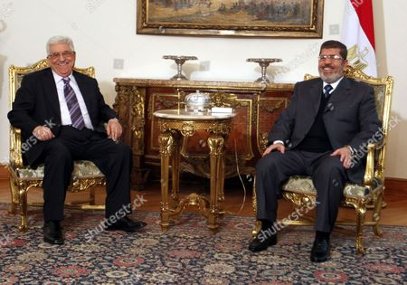 Egyptian President Mohamed Morsi (r) Meets with Palestinian President Mahmoud Abbas (l) at the Presidential Palace in Cairo Egypt 09 January 2013 According to Media Reports Egyptian President Mohamed Morsi Will on 09 January Meet President Mahmoud Abbas of the Fatah Party and Hamas Leader Khaled Meshaal to Push Unity Talks Between the Rival Palestinian Groups Egypt Cairo