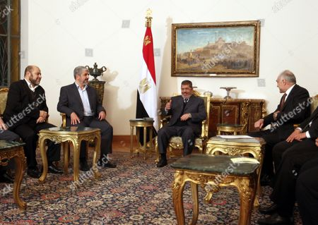 Egyptian President Mohamed Morsi (2-r) Meets with Palestinian Hamas Leader Khaled Meshaal (2-l) and Hamas Member Moussa Abu Marzouk (l) in the Presence of Egyptian Foreign Minister Mohammed Kamel Amr (r) at the Presidential Palace in Cairo Egypt 09 January 2013 According to Media Reports Egyptian President Mohamed Morsi Will on 09 January Meet President Mahmoud Abbas of the Fatah Party and Hamas Leader Khaled Meshaal to Push Unity Talks Between the Rival Palestinian Groups Egypt Cairo