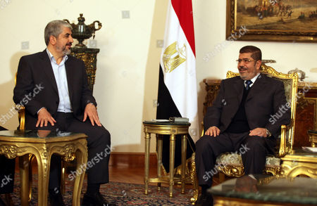Egyptian President Mohamed Morsi (r) Meets with Palestinian Hamas Leader Khaled Meshaal (l) at the Presidential Palace in Cairo Egypt 09 January 2013 According to Media Reports Egyptian President Mohamed Morsi Will on 09 January Meet President Mahmoud Abbas of the Fatah Party and Hamas Leader Khaled Meshaal to Push Unity Talks Between the Rival Palestinian Groups Egypt Cairo